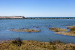 River flowing into the sea. Bay shore on sunny day. Scenic panorama of summer seacoast. Atlantic Ocean coast. River flowing into the sea. Bay shore on sunny day stock photography