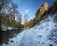 River flowing through snow covered Winter landscape in forest va Royalty Free Stock Photography