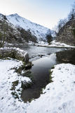 River flowing through snow covered Winter landscape in forest va Stock Photography