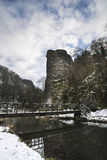 River flowing through snow covered Winter landscape in forest  Royalty Free Stock Photography