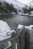 River Flowing Through Snow Covered Winter Landscape In Forest Va Stock Images