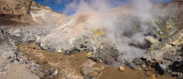 River Flowing Through The Canyon With Fumaroles Inside Mutnovsky Volcano Crater Royalty Free Stock Image