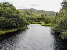 River flowing throughout a valley. River flowing throughout a scottish valley in the Highlands Stock Photo