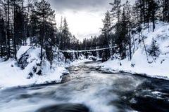 River flowing under bridge Royalty Free Stock Photo