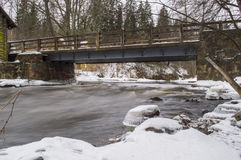 River flowing under bridge. River flowing underneath a birdge at winter Stock Images