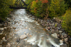 River flowing under railroad bridge Royalty Free Stock Image