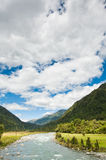 River flowing through a valley on a summer day Stock Photos