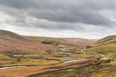 River flowing on a valley in Wales. Cloudy and stormy day in the countryside, tipycal welsh weather and landscape in autumn. Nature and travel concepts Royalty Free Stock Photos