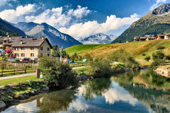 River Flowing Through Village of Livigno, Italy Royalty Free Stock Image