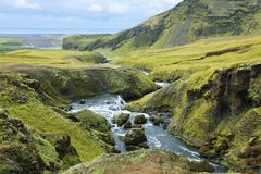 River flowing into the waterfall Skogarfoss in Iceland Royalty Free Stock Photography