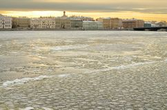 The river flows through the city. The first frost had coated it with ice royalty free stock photo