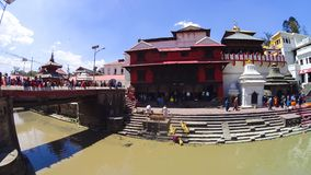 The river flows through the city of Kathmandu, separating it from the city of Patan. Stock Images
