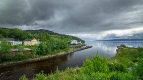 The river flows into the fjord with rain.4k time lapse footage. Norway summer stock video