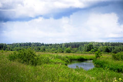 The river flows through the meadows in Belarus Stock Photo