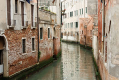 The river flows through the narrow streets of Venice between old Royalty Free Stock Image