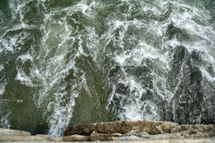 The river flows out of the culvert. Culvert outflow of the river, the waves stirred up Stock Photography