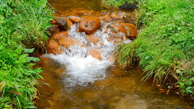 The river flows through the rocks stock footage