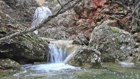 River flows through a rocky Stock Photo