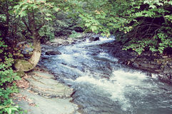 River flows in stony line Royalty Free Stock Photo