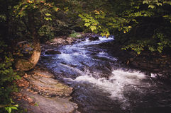 River flows in stony line Royalty Free Stock Photography