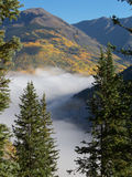 River of Fog. Dense fog travels through a valley during early Autumn in the Rocky Mountains stock photos