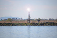 River Fog Beacon. A beacon used for helping boaters navigate a river during foggy conditions Royalty Free Stock Photography
