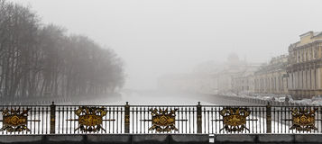The river Fontanka in the mist morning. The fog morning in the embankment of the Fontanka River. The Summer Garden. Saint Petersburg. Russia Stock Images