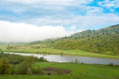 The river at the foot of the river. Giant cloud. Carpathians, Ukraine. The river at the foot of the river. Giant cloud. Carpathians, Ukraine Royalty Free Stock Image