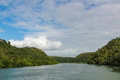 River, forest on the banks and cloudy sky in the Dominican Republic stock photos