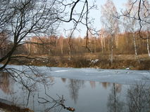 River in the forest near Moscow during the thaw. stock photography