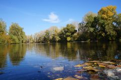 River and forest. Autumn, water, blue sky Royalty Free Stock Photos