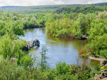 River with forest and rock outcrops on its banks Royalty Free Stock Photo