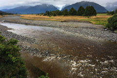 River from Fox glacier with rock foreground Stock Images