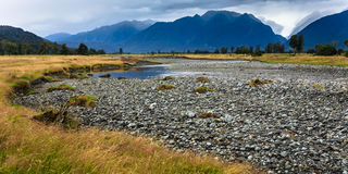River from Fox glacier with rock foreground Royalty Free Stock Photos