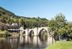 River of France with bridge. River of France on a sunny day with the trees and mountains  in the background. It´s a picture with houses in one side and a Royalty Free Stock Photo