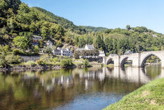 River of France with bridge. River of France on a sunny day with the trees and mountains  in the background. It´s a picture with houses in one side and a Royalty Free Stock Photography