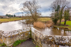 River Frome at Wool. The River Frome and the historic Wool Bridge Dorset England UK Europe Royalty Free Stock Images