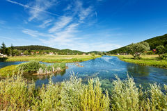 River Gacka near Otočac, Croatia. A place where the original flow of the river is diverted into a channel leading to the hydro power plant royalty free stock photography