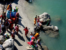 River Ganga. People taking holy dip in river Ganges at Rishikesh, India Stock Images