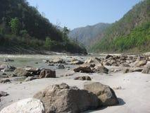 River Ganga. The Ganga river flowing across mountains in Rishikesh Stock Photos
