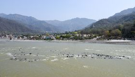 River Ganges in Rishikesh, India. River Ganges or Ganga flowing through the holy town of Rishikesh, Uttarakhand in India royalty free stock photos