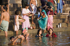 River Ganges in Varanasi - India. Hindu devotees bathing in the Holy River Ganges at the Hindu Ghats in Varanasi in the Uttar Pradesh region of Northern India Royalty Free Stock Photos