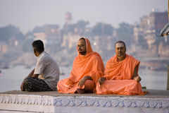 River Ganges - Varanasi - India. Pilgrims meditating on the Hindu Ghats at the Holy River Ganges in Varanasi ( Benares) in the Uttar Pradesh region of northern Royalty Free Stock Images