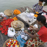 River Ganges - Varanasi - India. Children selling flowers and floating candles to pilgrims on the Hindu Ghats on the Holy River Ganges in Varanasi in the Uttar Stock Photography