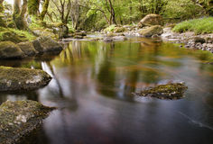 River glencree slowly flowing displaying beautiful reflections in the water. Tranquil scene of the glencree stream stock photos