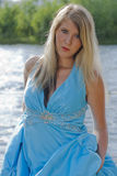 River Goddess. Sexy woman in a blue dress as a river goddess Royalty Free Stock Images