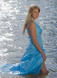 River Goddess. Sexy woman in a blue dress as a river goddess Stock Image