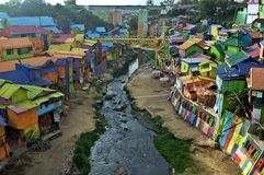A river going thru the colorful village of Jodipan stock photos