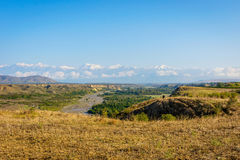 River, golden fields and snowy mountains, Azerbaijan Stock Images