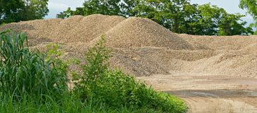 River gravel pile. The river gravel pile is sold for cement use in construction Stock Photos